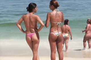 Dark suntanned skinned bitches on beach